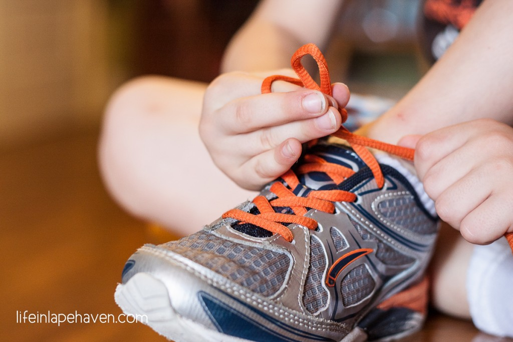 Life in Lape Haven: Trying & Tying - Elijah tying his shoelaces