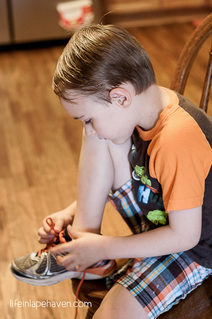 Life in Lape Haven: Trying & Tying - Elijah working to tie his shoelaces