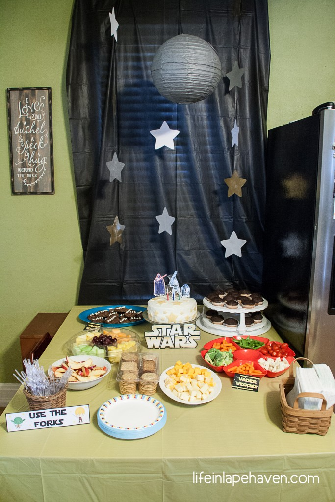 Life in Lape Haven: Josiah's Star Wars Birthday Party. Our littlest boy just turned three, and we celebrated with a fun Star Wars birthday party. Here is the scoop on our costumes, decorations, cake, and more with links to all the printables and recipes I used.